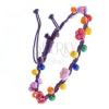 Karkötő összefonott madzagokból - lila színű, gyöngyökkel és virágokkal