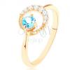 375 arany gyűrű - holdsarló átlátszó cirkóniákkal díszítve, kék topáz