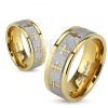Gyűrű acélból, arany színben, ezüst színű szatén sáv, keresztek