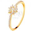 Gyűrű 14 sárga aranyból - csillogó virág átlátszó cirkóniákból, ragyogó szárak